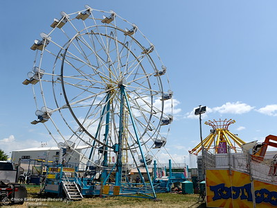 Rides begin to take shape as things get underway at the Silver Dollar Fairgrounds in Chico, Calif. Tues. May 22, 2018.  (Bill Husa -- Photos)