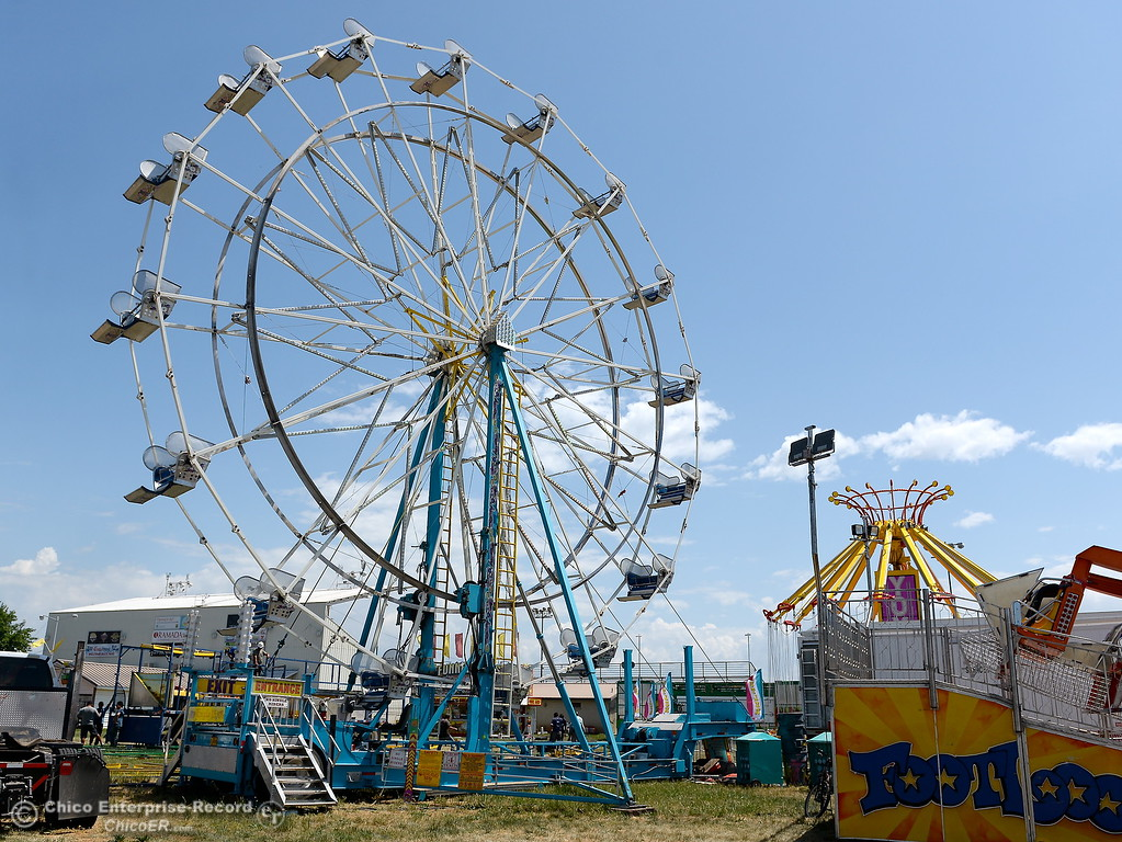 . Rides begin to take shape as things get underway at the Silver Dollar Fairgrounds in Chico, Calif. Tues. May 22, 2018.  (Bill Husa -- Photos)