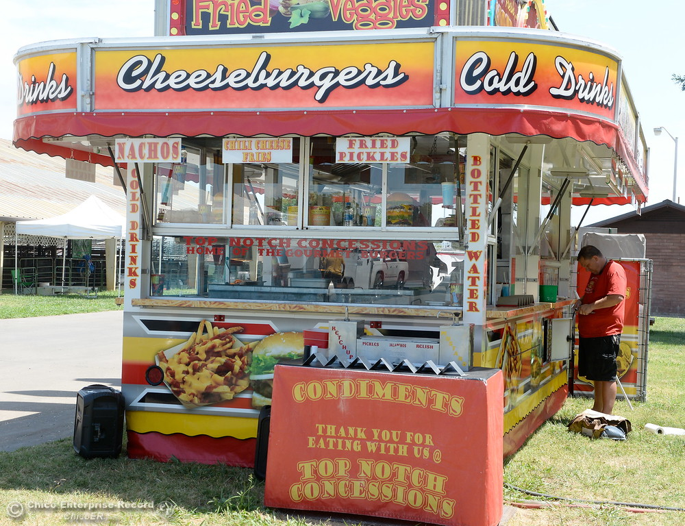 . The Top Notch Concessions serves up an awesome cheeseburger as I was told from a reliable source as things get underway at the Silver Dollar Fairgrounds in Chico, Calif. Tues. May 22, 2018.  (Bill Husa -- Photos)