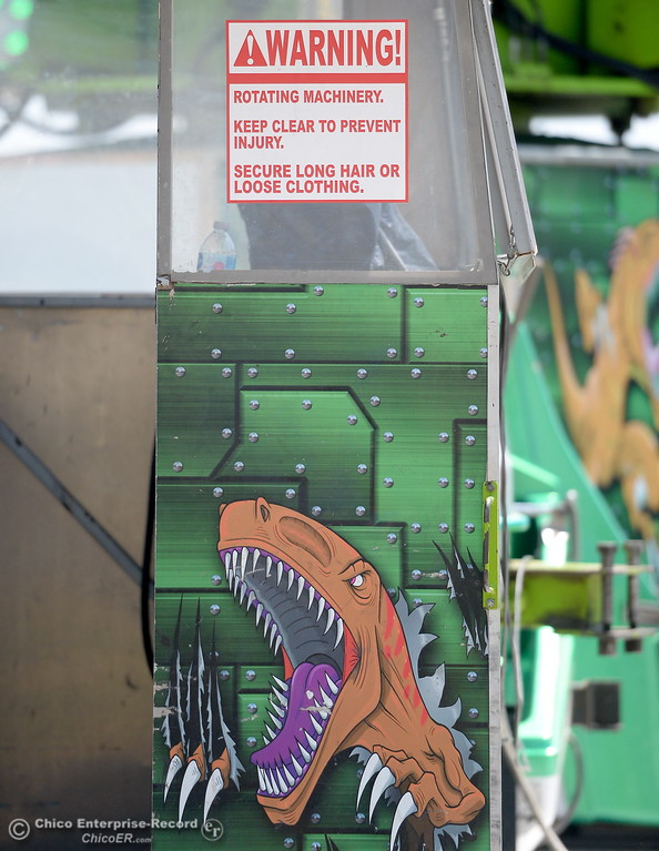 . A sign warns to keep loose clothing and long hair inside on this particular ride as things get underway at the Silver Dollar Fairgrounds in Chico, Calif. Tues. May 22, 2018.  (Bill Husa -- Photos)