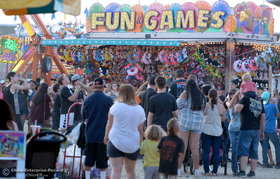 A crowd walks through the carnival area at the Silver Dollar Fair in Chico, Calif. Friday May 27, 2016. (Bill Husa -- Enterprise-Record)