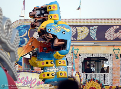 Brave souls fly through the air on a ride at the Silver Dollar Fair in Chico, Calif. Friday May 27, 2016. (Bill Husa -- Enterprise-Record)