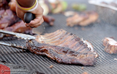 Ribs are cooked on a barbeque at the Silver Dollar Fair in Chico, Calif. Friday May 27, 2016. (Bill Husa -- Enterprise-Record)