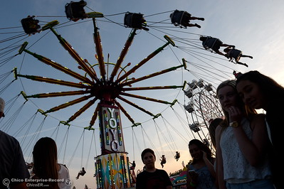 Riders of the YoYo ride enjoy a beautiful sunset as sounds of laughter and screams of joy fill the air at the Silver Dollar Fair in Chico, Calif. Friday May 27, 2016. (Bill Husa -- Enterprise-Record)