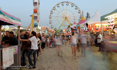 Fairgoers roam the grounds looking for fun at the Silver Dollar Fair in Chico, Calif. Friday May 27, 2016. (Bill Husa -- Enterprise-Record)