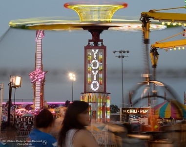 As the sun goes down the lights come on turning the rides into a kaleidoscope of colors for a slow shutter speed on a camera at the Silver Dollar Fair in Chico, Calif. Friday May 27, 2016. (Bill Husa -- Enterprise-Record)