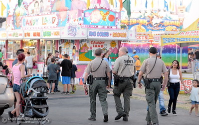 Several members of various law enforcement agencies are seen keeping fairgoers safe at the Silver Dollar Fair in Chico, Calif. Friday May 27, 2016. (Bill Husa -- Enterprise-Record)