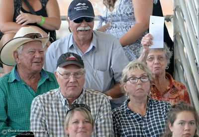 Buyers hold up their cards as Grand Champions and Reserve Grand Champions are auctioned off at the Silver Dollar Fair in Chico, Calif. Saturday May 28, 2016.  (Bill Husa -- Enterprise-Record)
