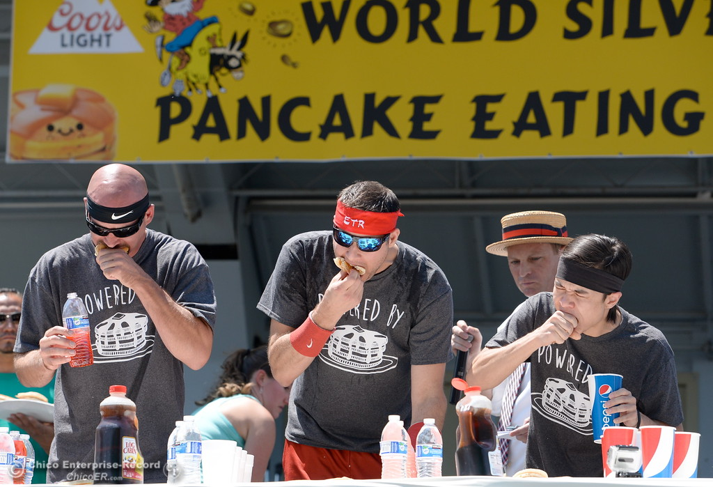 . Left to right, Steve Henry, Erik Denmark and Matt Stonie dig in during the Major League Eating World Championship Pancake Eating Contest at the Silver Dollar Fair in Chico, Calif. Saturday May 28, 2016.  (Bill Husa -- Enterprise-Record)