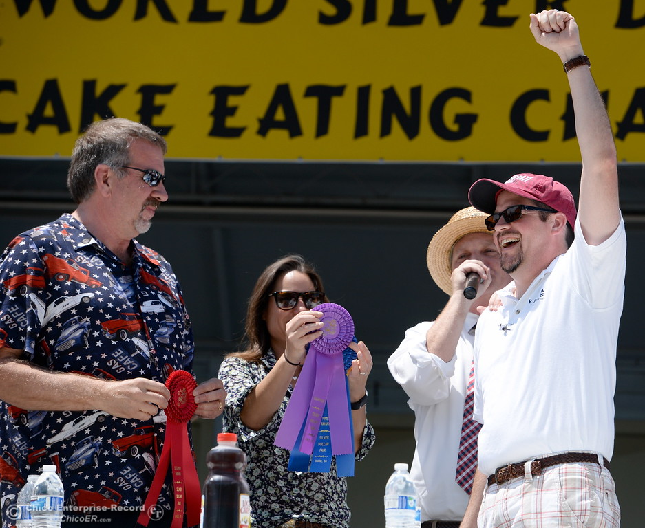 . Chico City Councilman Randall Stone raises his fist in victory as he wins first place during the celebrity edition of the World Championship Pancake Eating Contest at the Silver Dollar Fair in Chico, Calif. Saturday May 28, 2016.  (Bill Husa -- Enterprise-Record)