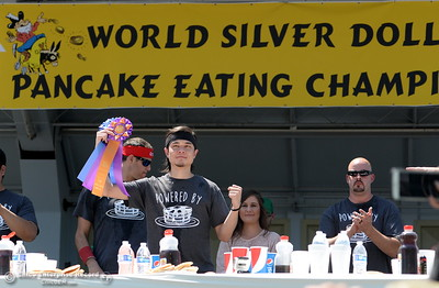 Matt Stonie raises a fist and a ribbon after winning the  Major League Eating World Championship Pancake Eating Contest by consuming 7.065 lbs. in 8-minutes at the Silver Dollar Fair in Chico, Calif. Saturday May 28, 2016.  (Bill Husa -- Enterprise-Record)