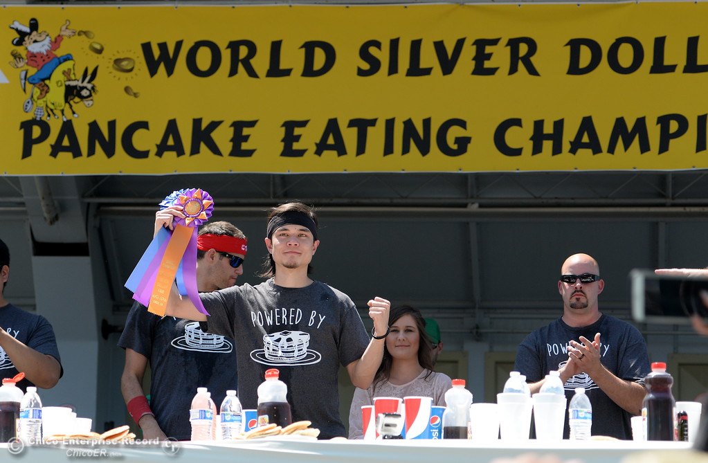 . Matt Stonie raises a fist and a ribbon after winning the  Major League Eating World Championship Pancake Eating Contest by consuming 7.065 lbs. in 8-minutes at the Silver Dollar Fair in Chico, Calif. Saturday May 28, 2016.  (Bill Husa -- Enterprise-Record)