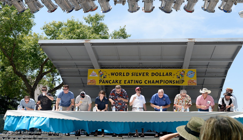. Contestants chow down during the celebrity edition of the World Championship Pancake Eating Contest at the Silver Dollar Fair in Chico, Calif. Saturday May 28, 2016.  (Bill Husa -- Enterprise-Record)