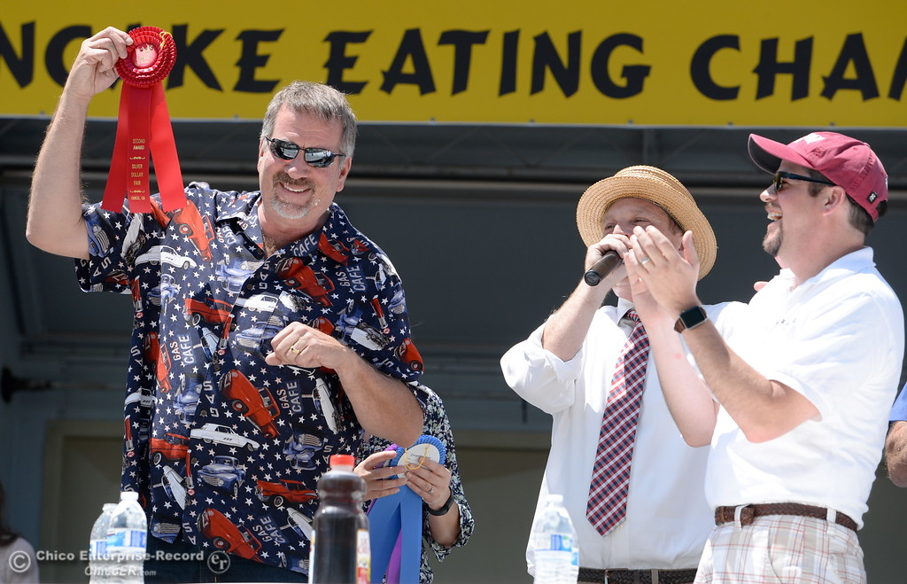 . Rep. Doug LaMalfa holds up his second place ribbon after the celebrity edition of the World Championship Pancake Eating Contest at the Silver Dollar Fair in Chico, Calif. Saturday May 28, 2016.  (Bill Husa -- Enterprise-Record)