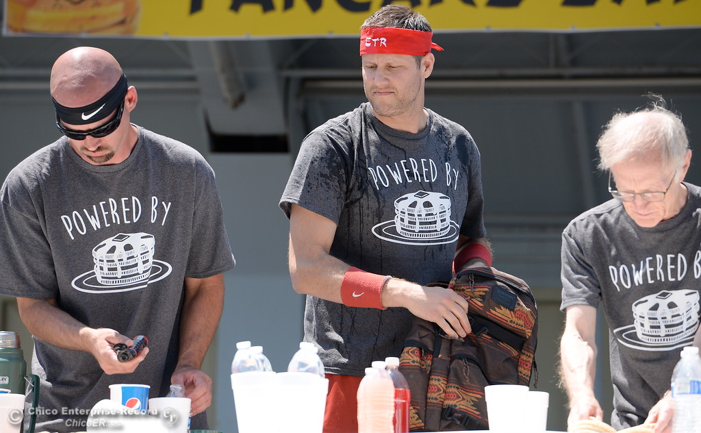 . Left to right, Steve Henry, Erik Denmark and Rich Leferve get ready for the start of the World Championship Pancake Eating Contest at the Silver Dollar Fair in Chico, Calif. Saturday May 28, 2016.  (Bill Husa -- Enterprise-Record)