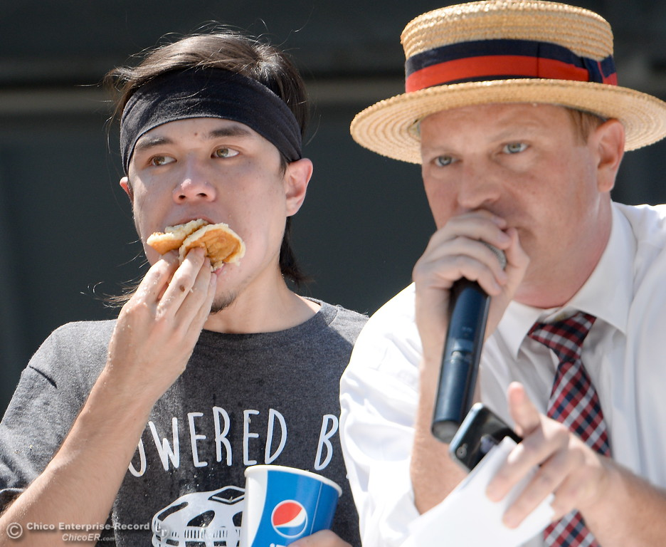 . Announcer Sam Barclay watches as Matt Stonie inhales 7.065lbs. of pancakes in 8-minutes to take the win during the Major League Eating World Championship Pancake Eating Contest at the Silver Dollar Fair in Chico, Calif. Saturday May 28, 2016.  (Bill Husa -- Enterprise-Record)