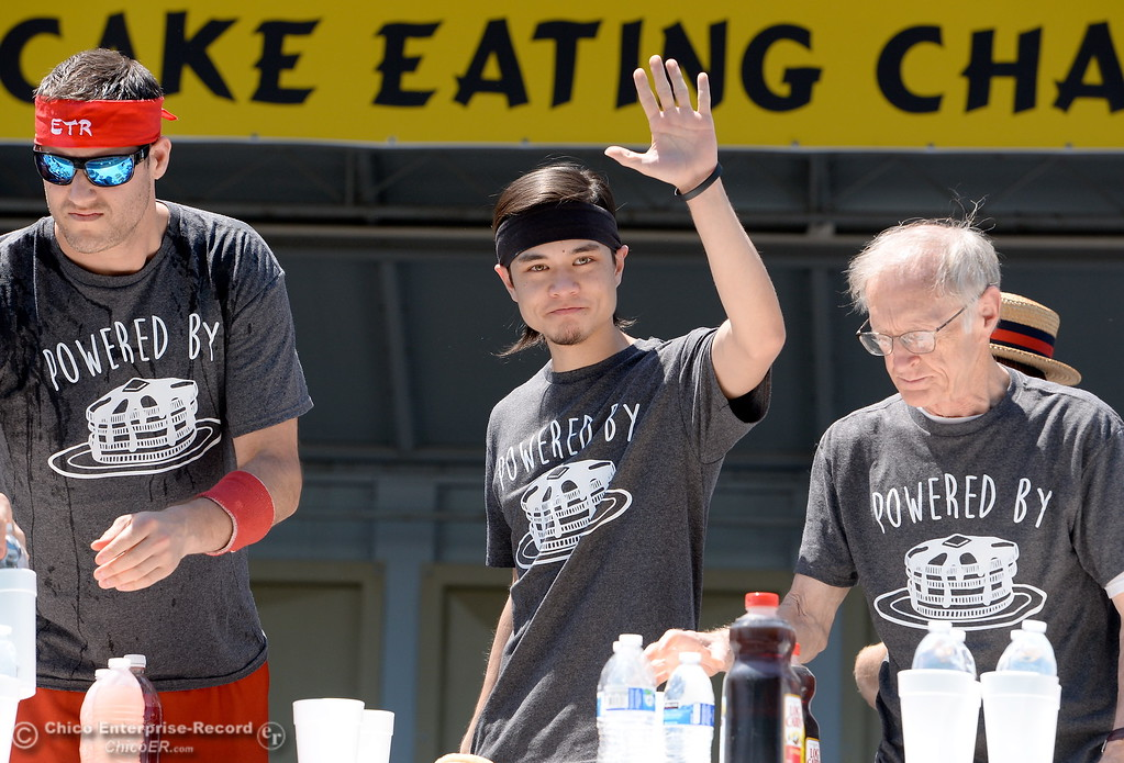 . World Champion Eater Matt Stonie waves to the crowd as he takes his place between Erik Denmark left and Richard LeFevre at right before the World Championship Pancake Eating Contest at the Silver Dollar Fair in Chico, Calif. Saturday May 28, 2016.  (Bill Husa -- Enterprise-Record)