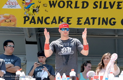 Erik Denmark celebrates a 4th place finish at the Major League Eating World Championship Pancake Eating Contest at the Silver Dollar Fair in Chico, Calif. Saturday May 28, 2016.  (Bill Husa -- Enterprise-Record)