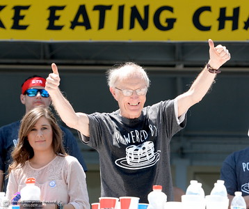 Rich LeFevre celebrates a 2nd place finish at the Major League Eating World Championship Pancake Eating Contest at the Silver Dollar Fair in Chico, Calif. Saturday May 28, 2016.  (Bill Husa -- Enterprise-Record)