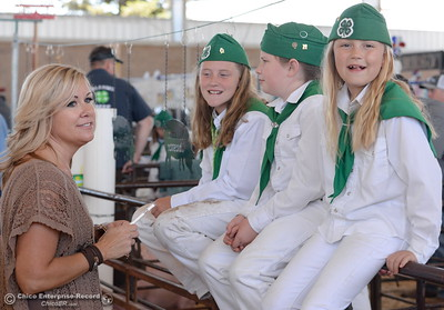 Left to right, Mom Ronni Owen of Chico chats with Ellie Gallaty 11, Marki Owen 10 and Gentry Sherrod while they sit on a fence near the market hog judging as things get underway at the Silver Dollar Fairgrounds in Chico, Calif. Wednesday May 25, 2016. (Bill Husa -- Enterprise-Record)