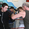Silver Mittens boxers training at West End Gym. Duni Morales, 13, of Lowell, left, who will box at 125 lbs, trains with Dave Ramalho. (SUN/Julia Malakie)