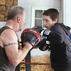 Silver Mittens boxers training at West End Gym. Duni Morales, 13, of Lowell, right, who will box at 125 lbs, trains with Dave Ramalho. (SUN/Julia Malakie)
