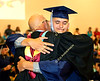 Graduating seniors give hugs to family and friends during the rose presentation.