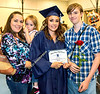 Zoey Sollers shows off her diploma while posing for a photo with her mother Kelly Dorman, left, sister Chloe Sollers, 3, and brother Noah Sollers.