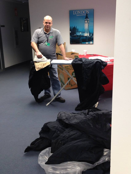 Ed Pizza removing logos and placing patches ... on 582 uniform coats donated to the homeless veterans