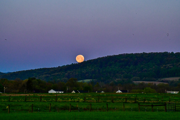 May 2020 supermoon - setting over a farm house