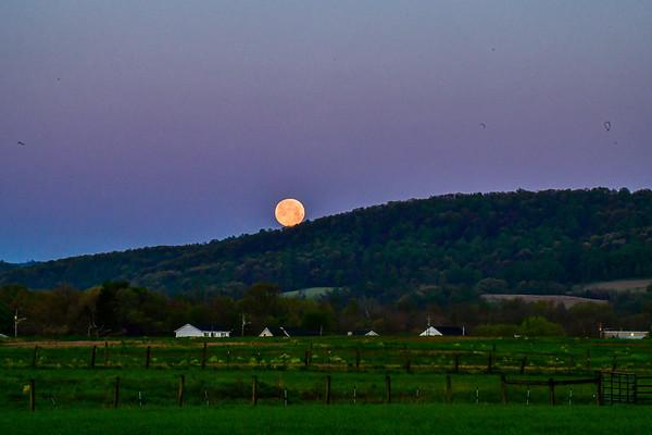 May 2020 supermoon - setting over a farm house