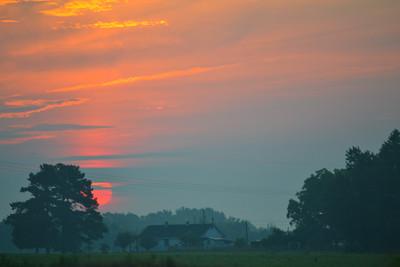 Misty Sunrise over a Rural House