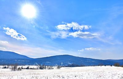 Winter Sun in a snowy field