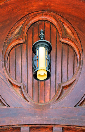 Light Sconce on Carved Wood