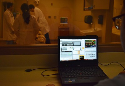 Behind one-way glass an instructor can monitor the student's work and directly change how the mannequin reacts to the treatments inside one of the high fidelity simulation rooms at the new Simulation Center at St. Joseph Mercy Oakland in Pontiac on Sept. 29, 2016.