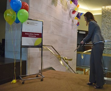 Shannon Striebich, president at St. Joseph Mercy Oakland, cuts a ribbon to signify the opening of the new Simulation Center at St. Joseph Mercy Oakland in Pontiac on Sept. 29, 2016.