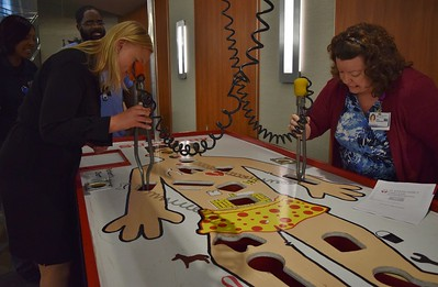 Hospital staff play a large-scale game of Operation inside the Education Center at St. Joseph Mercy Oakland in Pontiac on Sept. 29, 2016.