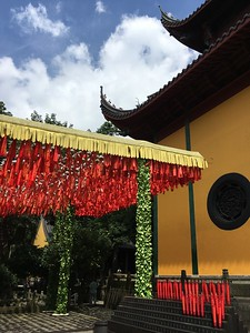 I believe the red ribbons have  prayers at this Buddhist temple.