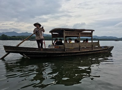 a calmer mode of transportation on West Lake in Hangzhou
