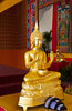 A golden buddha image at the Buddha Tooth Relic Buddhist Temple in Chinatown, Singapore, East Asia.