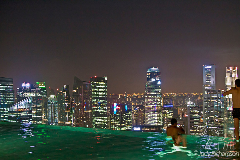 Night lights reflecting in the infinity pool at Marina Bay Sands Hotel in Singapore.