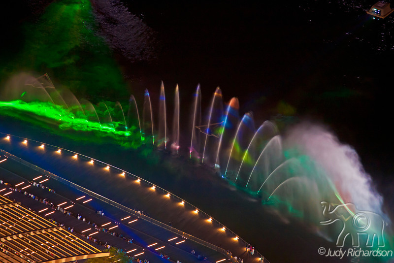 Multi-colored laser light and water show from on top of the Marina Bay Sands Hotel.