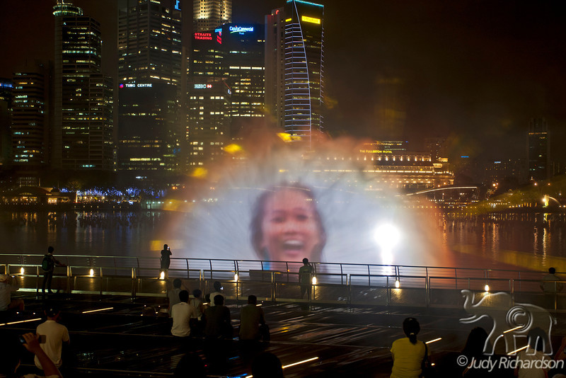 Images created by colored lasers & lights combined with sound in the fountain mist of Marina Bay.