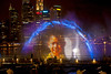 """A child is created by colored lasers & lights combined with sound in the fountain mist of Marina Bay """"Wonder Full"""" show."""
