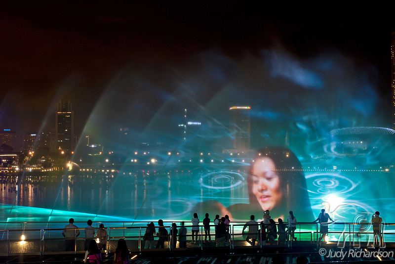 Images created by colored lasers & lights combined with sound in the fountain mist of Marina Bay offers a spectacular sight each night.