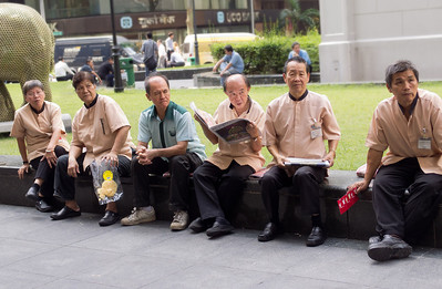 Cleaning staff taking a break at Raffles Place