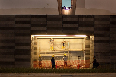 Workers at SOTA, the School Of The Arts, working late into the night