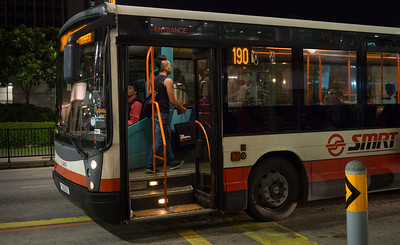 Boarding a late night bus on Orchard Road, Dec 2012.