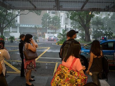 When it rains in Singapore, it is a challenge to find a taxi.