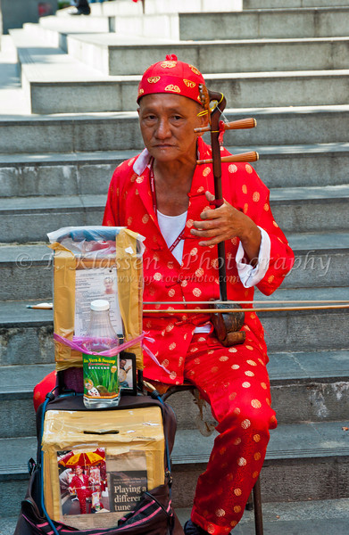 Chinese folk entertainer in Chinatown, Singapore, East Asia.